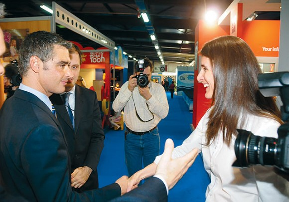 Tourism Development Minister Aris Spiliotopoulos greets Greek Travel Pages Publisher Maria Theofanopoulou at the GTP stand.