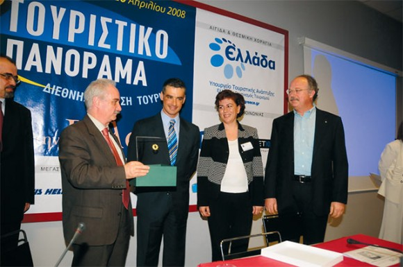 President of the Hellenic Association of Travel and Tourist Agencies (HATTA), Yiannis Evangelou with Tourism Development Minister Aris Spiliotopoulos, HATTA Vice President Argyro Fili and HATTA Director at Large Vassilis Kondos. The association was honored at the exhibition for its eighty-year contribution to the Greek tourism sector.