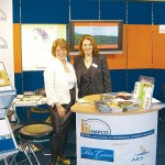 """Lydia Mastronikolis, director of the Hellenic Association of Professional Congress Organziers (HAPCO), with Elena Margaropoulou, manager of exhibitions and incentives for Kalofolia EXPRESS Group, at the HAPCO stand. This is the fourth-year-running that HAPCO takes part in Touristiko Panorama. According to HAPCO Marketing & Communication Executive Yiannis Kyparissopoulos, """"HAPCO's participation aims to underline the significance of conference tourism in the development of a sustainable Greek tourism product."""" The HAPCO stand was also the ambassador for AKS Hotels Conference Center, Park Hotel Athens, Porto Carras Grand Resort & Conference Center and Rodos Palace Resort Hotel & Conference Center, amongst others."""