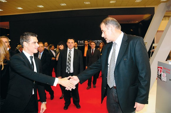 Tourism Minister Aris Spiliotopoulos greets Greek Travel Pages' sales and advertising manager, Thanassis Cavdas, at the GTP stand.