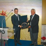 The Hellenic Hotel Federation's honorary chairman and president of the Rhodos Hoteliers Association, Vasilis Minaidis, received an honorary plaque from Tourism Minister Aris Spiliotopoulos for his valuable presence within the hotel industry. The award was given within the framework of the federation's presidents meeting during the Philoxenia exhibition.