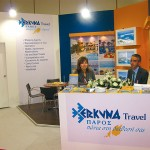 "Maria Stamouli, reservations specialist, and Giorgos Gavalas, ticketing department supervisor, at the stand of Paros-based Erkyna Travel that claims to be ""always at your disposal"" on Paros Island."