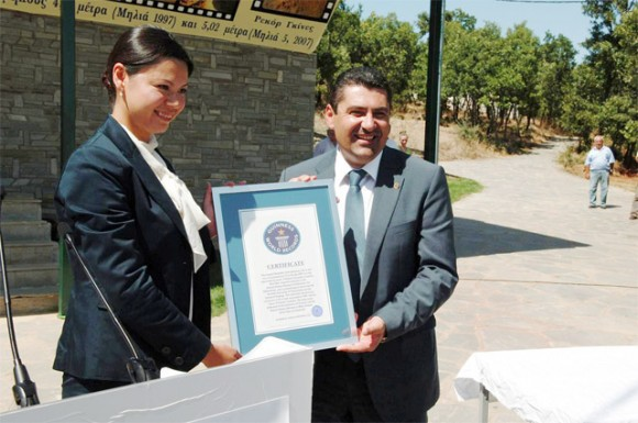Grevena Prefect Dimosthenis Kouptsidis shows off the official certificate from Guinness World Records that certifies that the two record-breaking mastodon tusks found by palaeontologists at Milia, Grevena are the longest ever found.