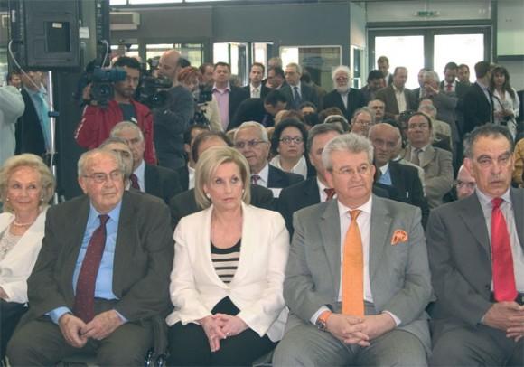 Tourism Development Minister Fanni Palli-Petralia sits with the chairman of the Kalofolias Group, Dimitris Kalofolias.