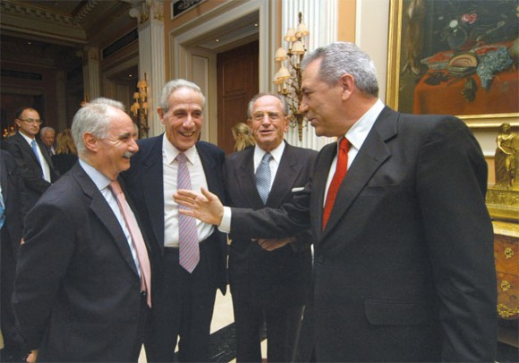 Yiannis Evangelou, gets words of wisdom from the health minister, Dimitris Avramopoulos, during Hellenic Chamber of Hotels' annual New Year's reception. To the minister's right is Hellenic Chamber of Hotels President Makis Fokas.