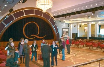 Local journalists get an idea of the expansiveness the luxury aboard the QE 2 during a familiarization tour of the ship after an invitation from Cruiseplan, a Eurostar subsidiary, which is the representative in Greece for QE 2's owner, Cunard.