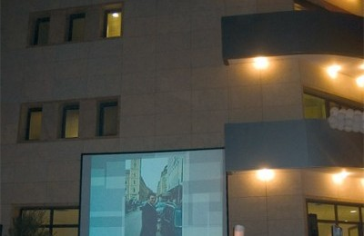 Guests at the inauguration were treated to a slideshow of the life of Mr. Fountas, with the new premises in the background.