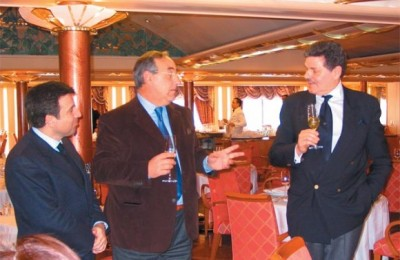 Andreas Stylianopoulos of Navigator Travel with unidentified collaborator, and Aris Zarpanely, executive vice president of Silversea Cruises as they toast to cruise vessels under construction.