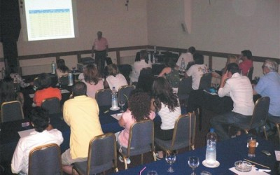 The company's staff attending a briefing by the general manager, Nikos Bolias.