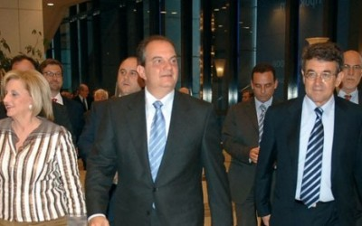 Tourism Minister Petralia with Prime Minister Kostas Karamanlis and Stavros Andreadis of the Association for Greek Tourist Enterprises at the assosiation's 14th open assembly.