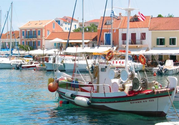 Fiskardo's colorful buildings and boat-filled harbor.