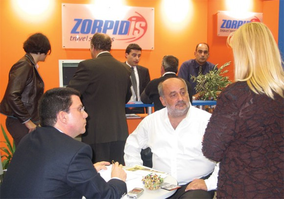 The Zorpidis Tourism Organization stand was without a doubt the busiest professional stand within the fair. Here, Michalis Zorpidis (center) stickhandles clients, customers and staff as he did throughout the four days of the fair.