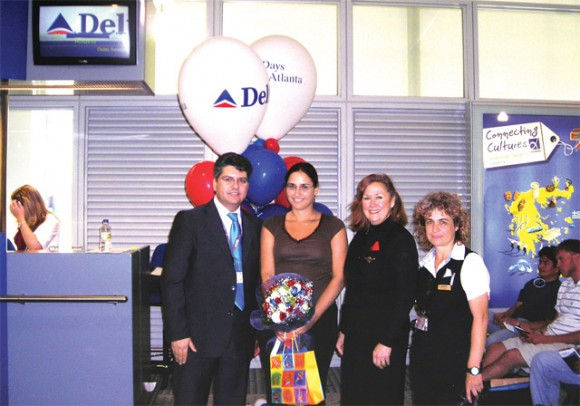 Dimitris Karagioules, Delta's commercial director with Paraskevi Sideri, the winner, a crew-member, and Voula Gravani, ACS Supervisor for Delta at Eleftherios Venizelos.