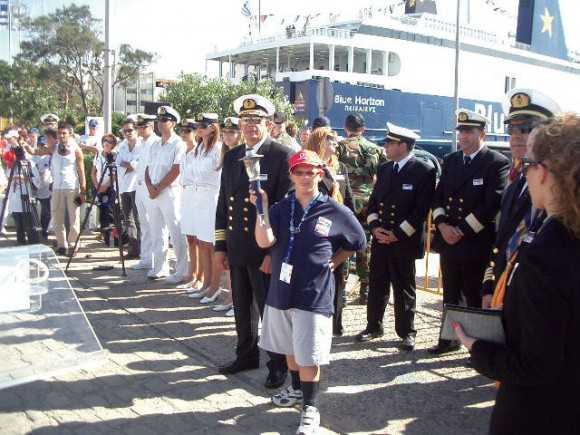 Captain Charalambos Tsimaras and the torchbearer with the Blue Horizon crew before sailing to Italy.