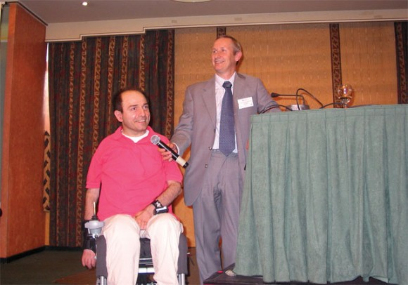 Nikos Voulgaropoulos of Disability Now, Greece, with Ivor Ambrose, OSSATE's coordinator for EWORX Greece, during the former's speech on the development of One-stop-shop for Accessible Tourism in Europe.