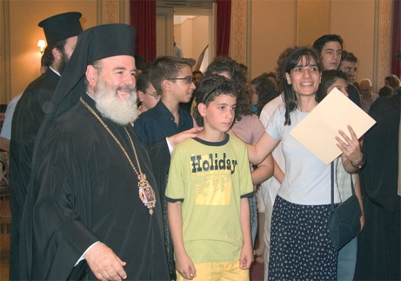 Archbishop Christodoulos congratulating a student and teacher from the Avgoulea-Linardatou School of Peristeri in Attica.