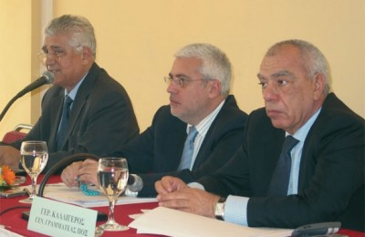 Vassilis Minaidis, president of the Panhellenic Hoteliers' Federation; board member Spyros Divanis; and secretary general of the federation, Gerasimos Kalligeros.