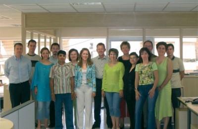 Joergen Esser, center, owner and managing director of Esser Travel, with his 16-member staff.