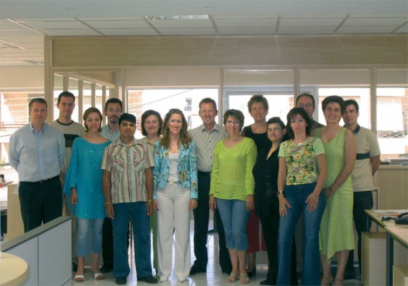 Joergen Esser, center, owner and managing director of Esser Travel, with his 16-member staff.