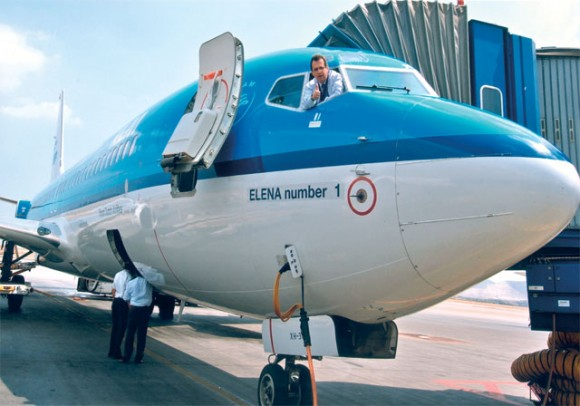 """SkyTeam Alliance member KLM Royal Dutch Airlines's country manager for Greece, Panagis Vassilatos, greets guests from the cockpit of """"Elena number 1"""" named in honor of Greece's recent win of the Eurovision song contest."""