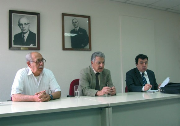 Vassilis Plevris, vice president of the Chamber of Greek Hotels; Professor Panayiotis Pavlopoulos; and Dr. Grigoris Papanikou.