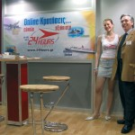 24 Hours Tourism Travel's chairman, Antonis Seretis, with just one of the many and very attractive female hosts that worked the stand all during the fair. Besides package travel for domestic and foreign destinations, the company specializes in hotel bookings and honeymoon packages.