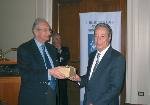 Former president of the Hellenic Tourism Organization, John Stefanides, hands the Hellenic Association of Travel & Tourism Agents' honor award to Christodoulos Sbokos of Sbokos Tours, Heraklion, Crete, for his more than a quarter of a century of service to the travel trade.