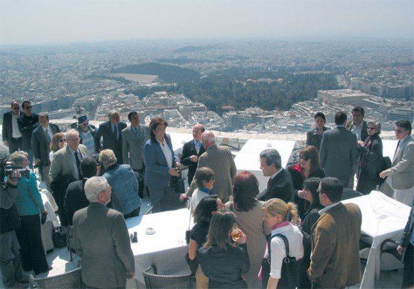 Athens Mayor Dora Bakoyannis (center) gives the foreign press corps an idea of the works underway to upgrade Lycabettus and other areas of the capital.