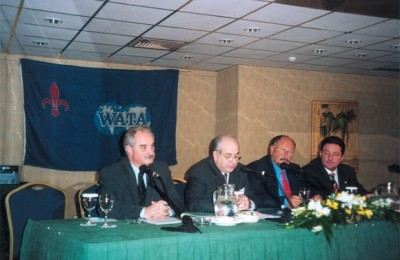 Yiannis Evagelou, president of the Hellinic Association of Travel and Tourism Agents; Ghassan Saad, president of the World Association of Travel Agents; Yiannis Patellis, president of the Hellenic Tourism Organization; and Vassilis Niadas, 2004 Games Support general manager.