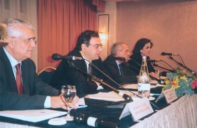 Panhellenic Hoteliers Federation President Vassilis Minaides, Economy and Finance Minister Nikos Christodoulakis, Hotel Federation's Georgos Kalligeris, and Athens Mayor Dora Bakoyiannis.