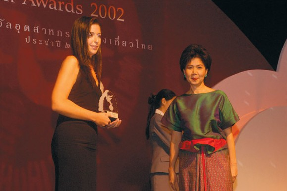 Zana Mirilla, marketing manager for Amazing Holidays accepts a best tour operator award from the Thai government's representative.