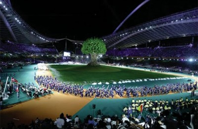 In the center of the sold-out stadium was a realistic-looking 26-meter tall plane tree made of Styrofoam, which symbolized strength and longevity.