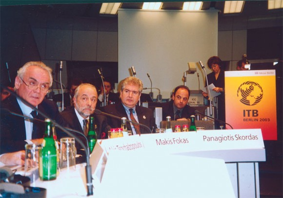 """Development Minister Akis Tsohatzopoulos (left), during a press conference at ITB, said: """"Uncertainties arising from the prospect of a war in Iraq are bound to affect Greek tourism, but only to a small extent. There are clear delays in bookings in all southern European countries...but the deficit in April and May arrivals will be made up by the end of the year."""" He expects a 10-15% drop in arrivals from Germany to Greece."""