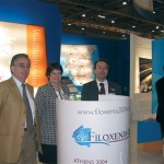 Antonis Seretis, managing director of 24 Hours Travel Service, with Elaine LeJambe and Konstantinos Pallis of Filoxenia '04, on the Athens 2004 stand.