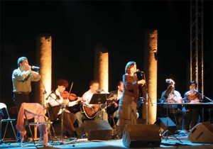 Music and poetry under the moonlight at the Ancient Roman Market.